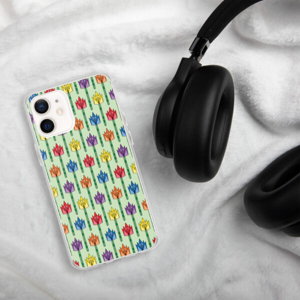 iphone case with a pattern of tulips in a midcentury style with rainbow colors sitting next to headphones