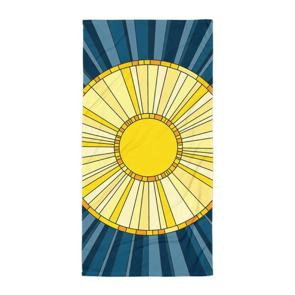 beach towel with a yellow sun design on a blue background