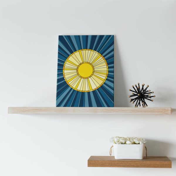vertical stretched canvas print with a design of a yellow sun on a blue background sitting on a shelf