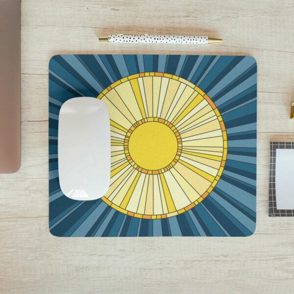 mouse pad with a yellow sun on a blue background with a computer mouse