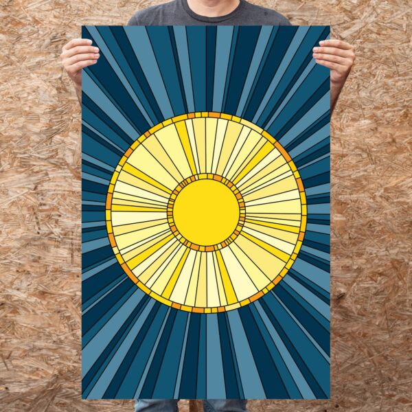 person holding a large vertical fine art print with a yellow sun design on a blue background