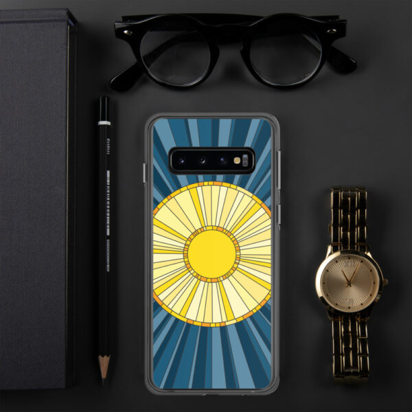 samsung phone case with a geometric design of a yellow sun on a blue background sitting next to a watch