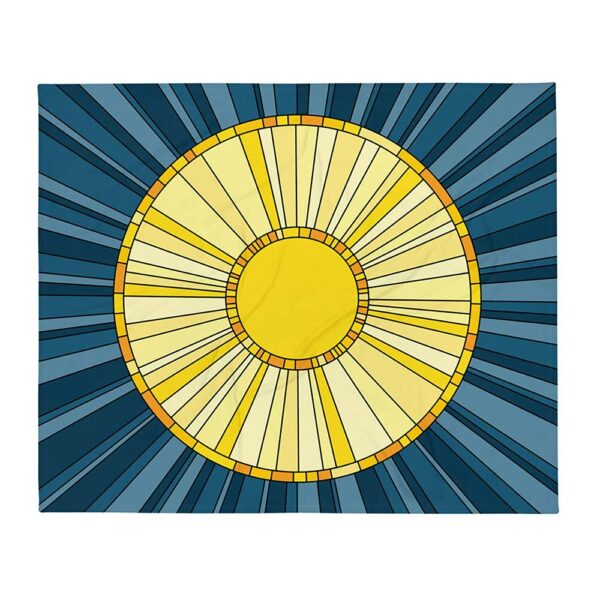 blanket with a large yellow sun on a dark blue background