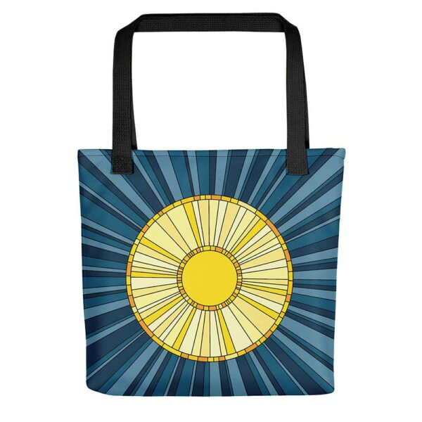 tote bag with black handles and a yellow sun design on a blue background