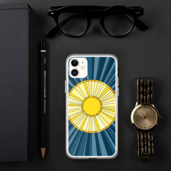 iphone case with a geometric design of a yellow sun on a blue background sitting next to a watch