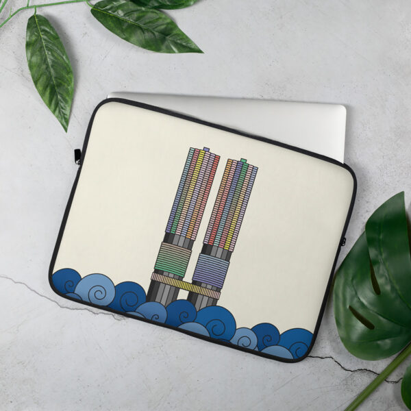 laptop sleeve with a colorful illustration of the two marina city towers in chicago sitting on a table