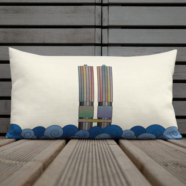 rectangle pillow with a colorful illustration of the two marina city towers in chicago with a yellow background sitting on a deck