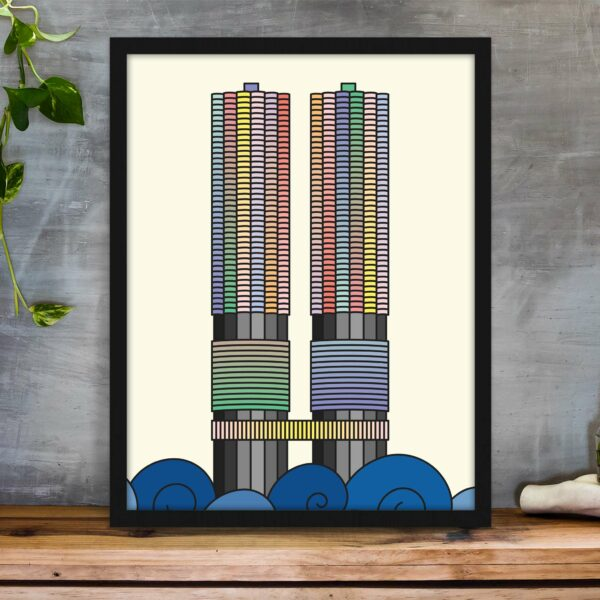 vertical fine art print with a colorful illustration of the two Marina City towers in Chicago in a black frame on a table