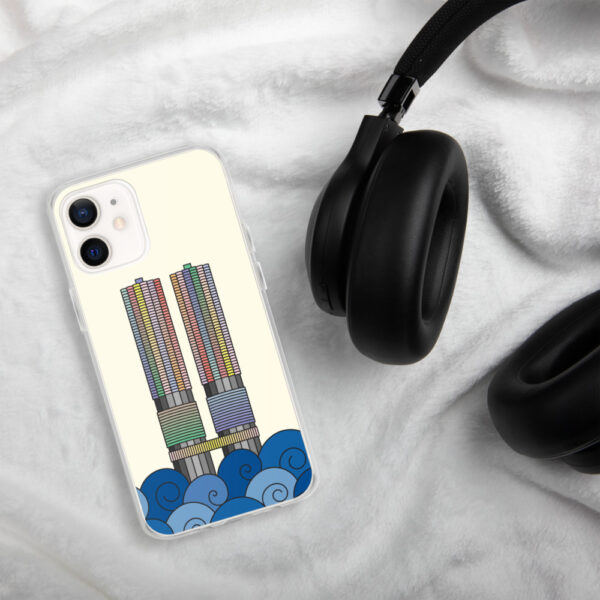 iphone case with a colorful illustration of the marina city buildings in chicago with waves at the bottom sitting next to headphones