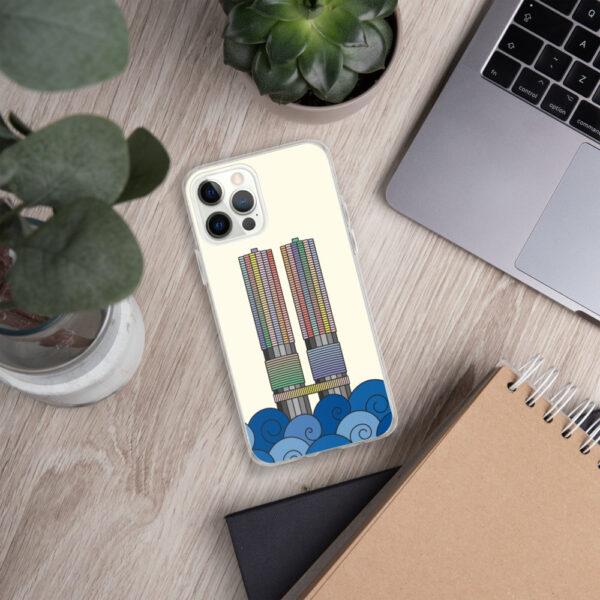 iphone case with a colorful illustration of the marina city buildings in chicago with waves at the bottom sitting next to a laptop