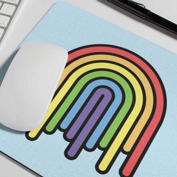 mouse pad with a colorful dripping rainbow design with a computer mouse