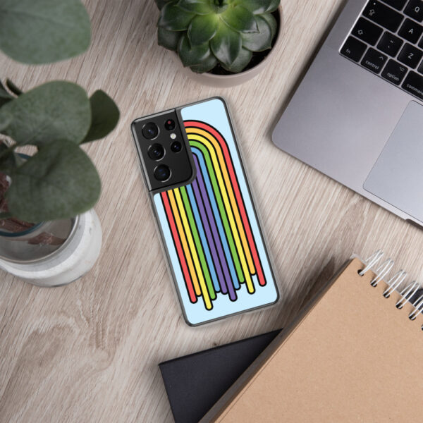 samsung phone case with a colorful dripping rainbow design on a light blue background sitting next to a laptop