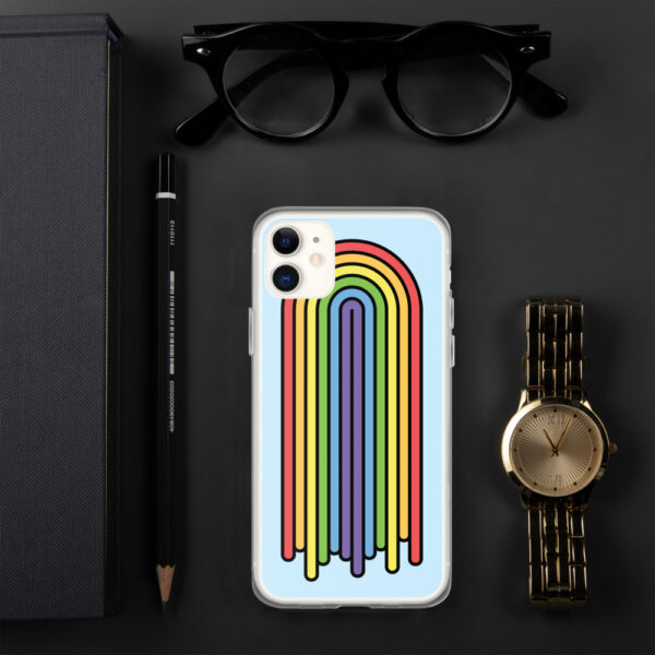 iphone case with a colorful dripping rainbow design on a light blue background sitting next to a watch