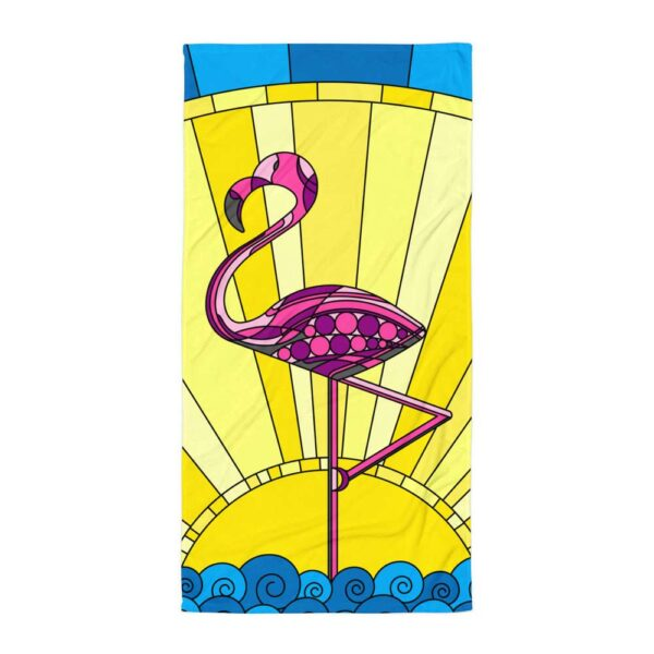 beach towel with a colorful pink flamingo standing in water in front of a sun