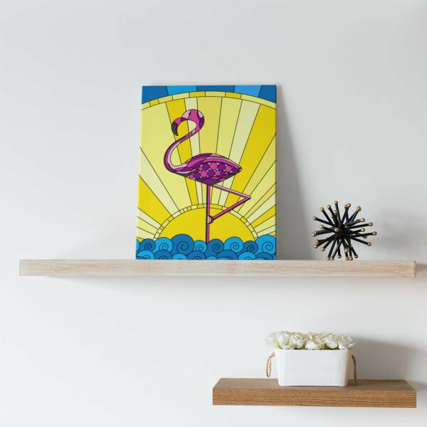 vertical stretched canvas print with a colorful scene of a pink flamingo standing in water with a yellow sun in the background sitting on a shelf
