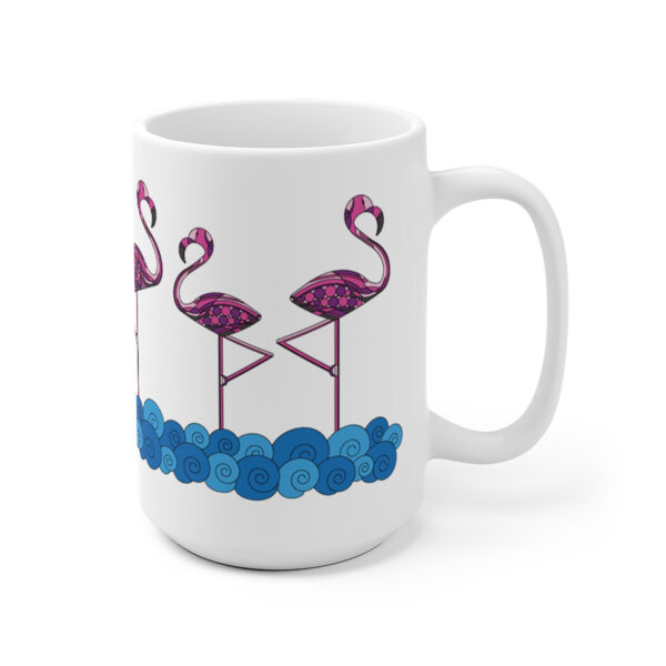 15 ounce white ceramic coffee mug with a design of pink flamingos standing in water wrapped around the sides
