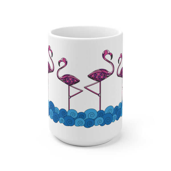 side view of a white ceramic coffee mug with a design of pink flamingos standing in water wrapped around the sides