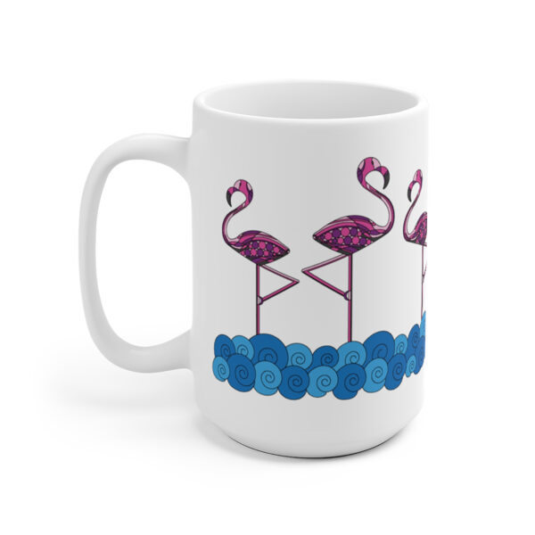back side of a white ceramic coffee mug with a design of pink flamingos standing in water wrapped around the sides