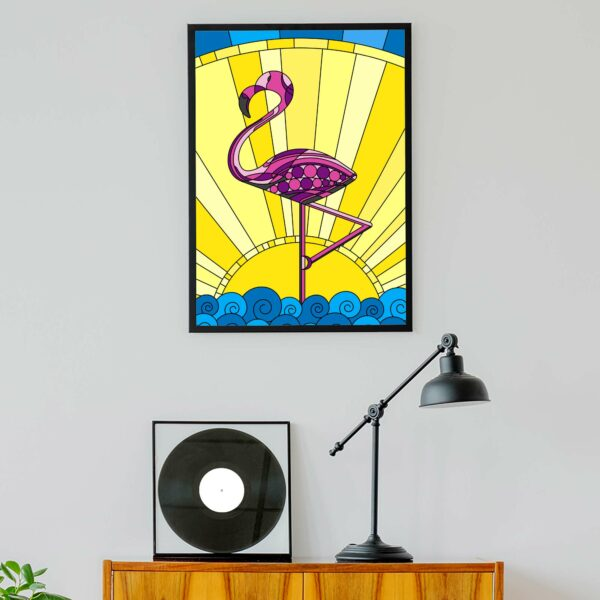 vertical fine art print with a tropical pink flamingo design in a black frame hanging on a wall