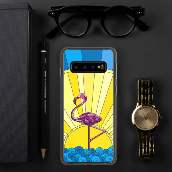 samsung phone case with a tropical design of a pink flamingo standing in water with a sun in the background sitting next to a watch