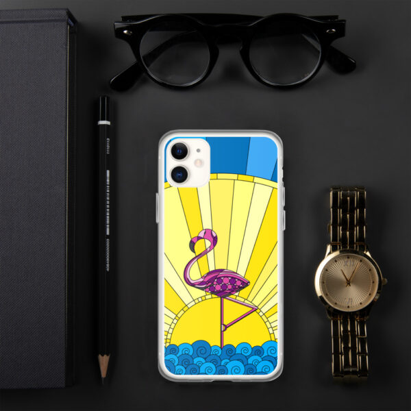 iphone case with a tropical design of a pink flamingo standing in water with a sun in the background sitting next to a watch