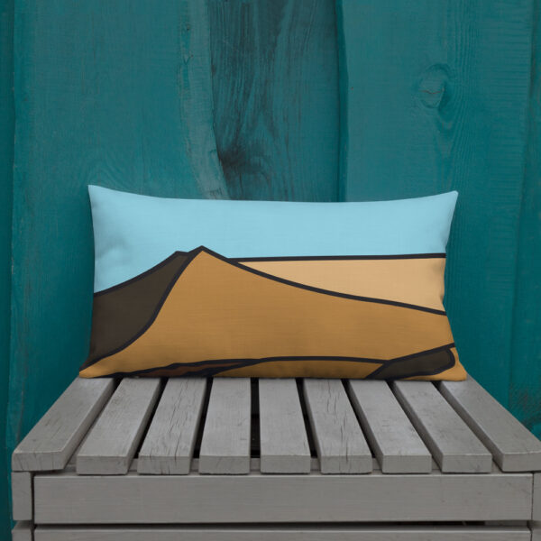 rectangle pillow with a minimalist desert sand dune landscape design sitting on a bench