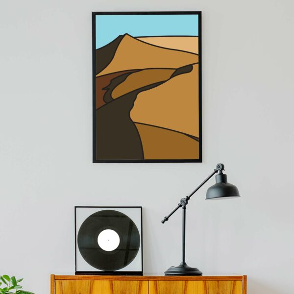 vertical fine art print with a minimalist sand dune design in a black frame hanging on a wall