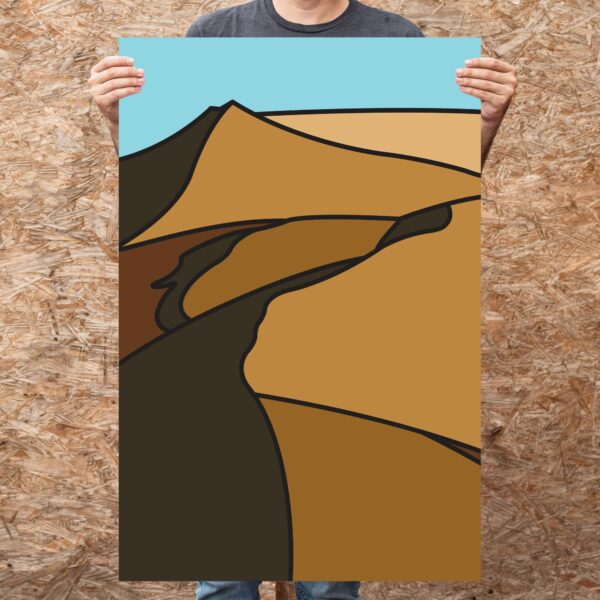person holding a large vertical fine art print with a minimalist sand dune design