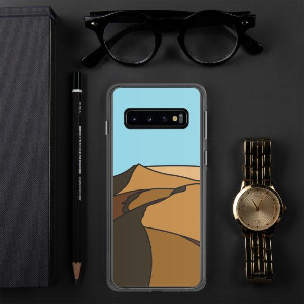 samsung phone case with a minimalist desert landscape design sitting next to a watch