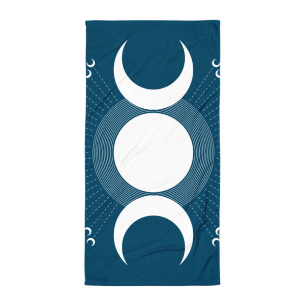 beach towel with a white moon design on blue background