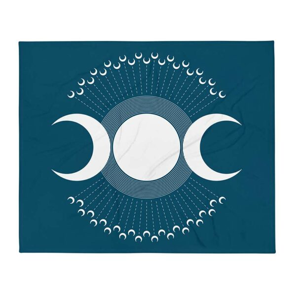 dark blue blanket with three large white moons and many smaller white moons