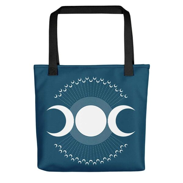 blue tote bag with black handles and a design of three white moon phases surrounded by smaller moons