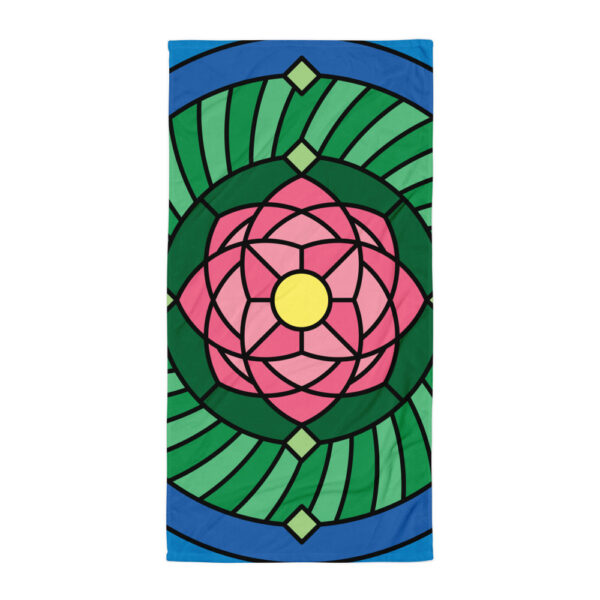 beach towel with a colorful pink and green lotus flower design