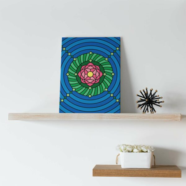 vertical stretched canvas print with a colorful pink green and blue lotus flower design sitting on a shelf