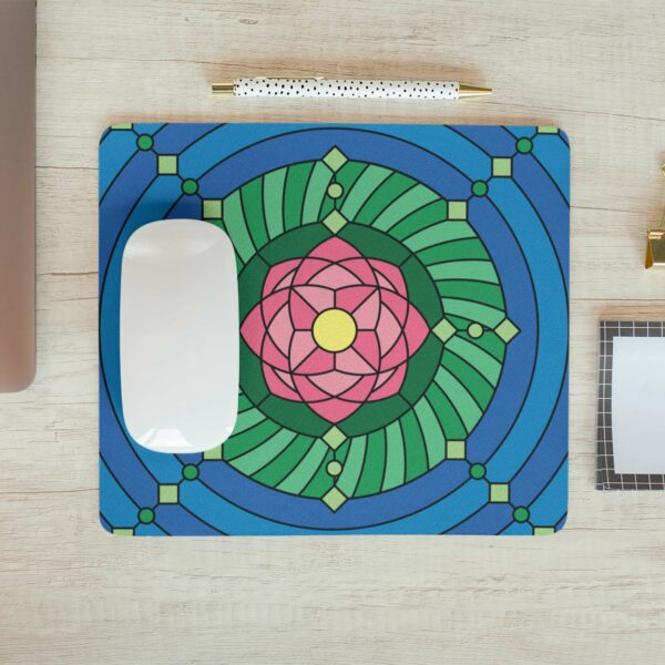 mouse pad with a colorful pink green and blue lotus flower design with a computer mouse