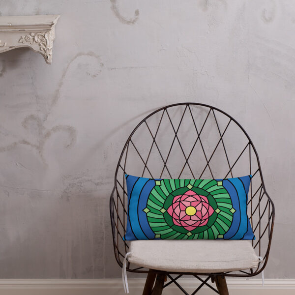 rectangle pillow with a pink green and blue lotus flower design sitting on a chair