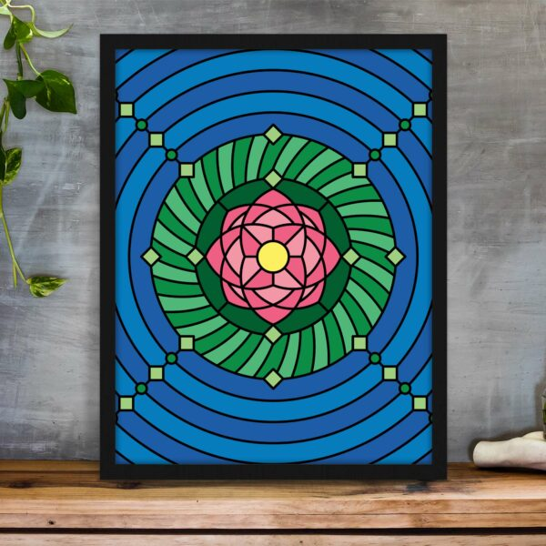 vertical fine art print with a colorful pink green and blue lotus flower design in a black frame on a table