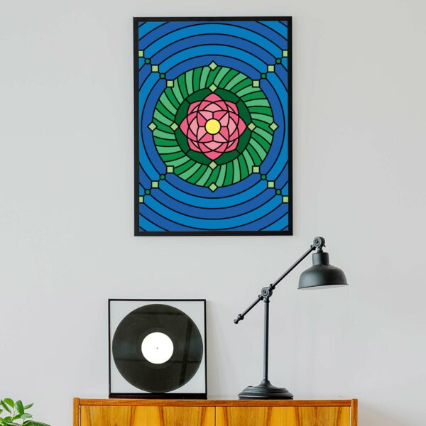 vertical fine art print with a colorful pink green and blue lotus flower design in a black frame hanging on a wall