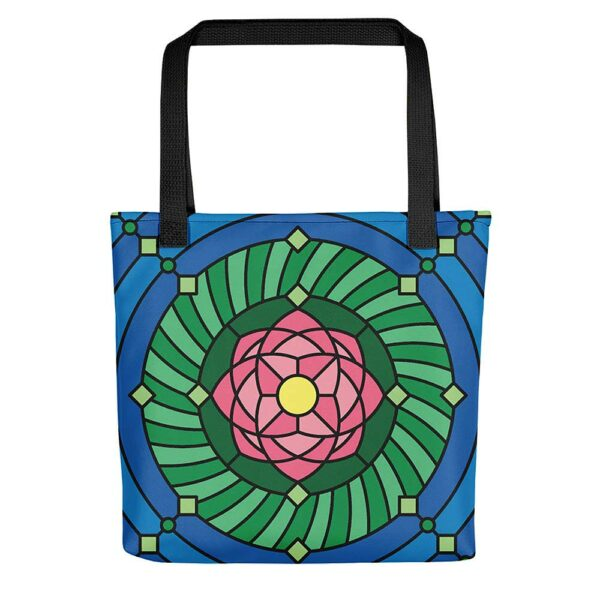 tote bag with black handles and a pink green and blue lotus flower design