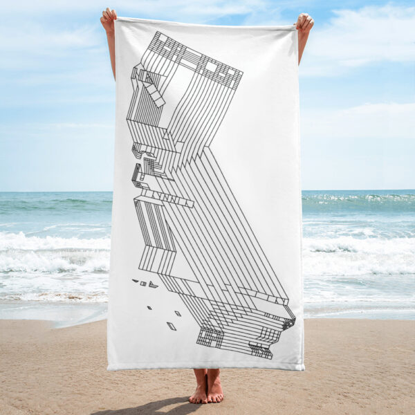 person on a beach holding a white beach towel with a black line drawing of the state of california