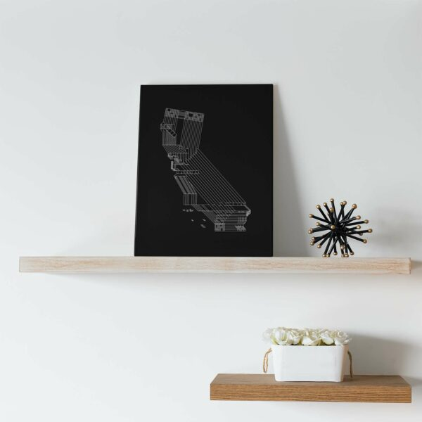 vertical stretched canvas art print of a white line drawing of the state of california on a black background sitting on a shelf