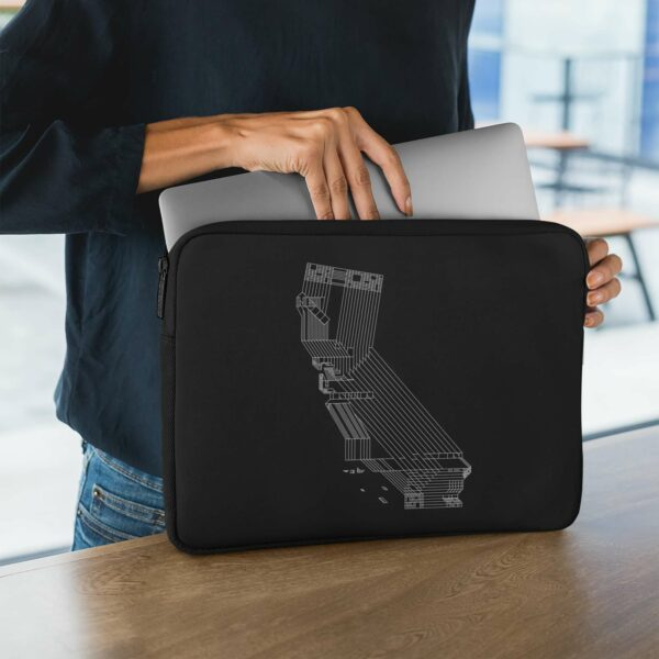person holding a laptop sleeve with a white line drawing of the state of california on a black background