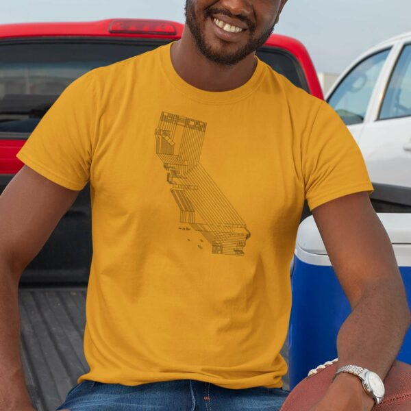 man wearing a golden yellow short sleeve t-shirt with a black line drawing of the state of california design