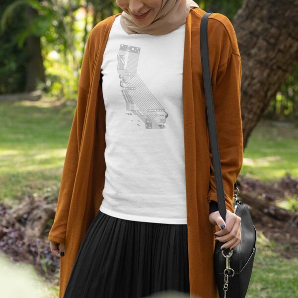 woman wearing a white short sleeve t-shirt with a black line drawing of the state of california design