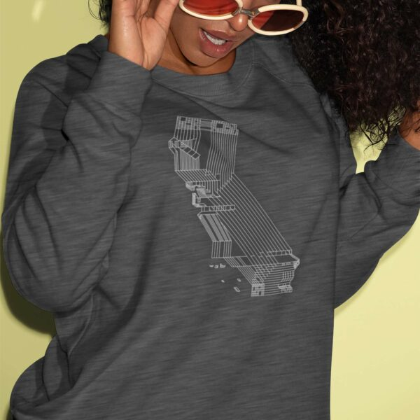 woman wearing a dark grey long sleeve sweatshirt with a white line drawing of the state of california design