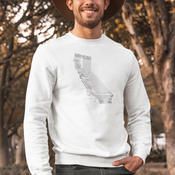 man wearing a white long sleeve sweatshirt with a black line drawing of the state of california design