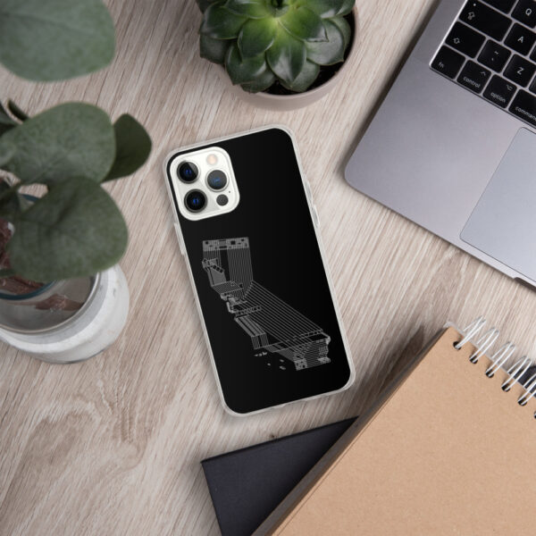 iphone case with a white line drawing of the state of california on a black background sitting next to a laptop