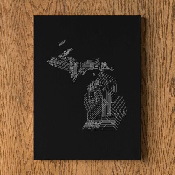 vertical stretched canvas art print of a white line drawing of the state of michigan on a black background hanging on a wall