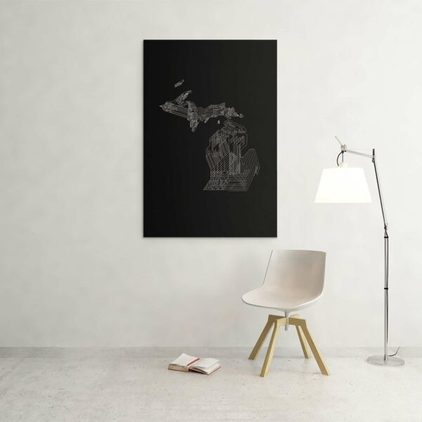 large vertical stretched canvas art print of a white line drawing of the state of michigan on a black background hanging on a wall