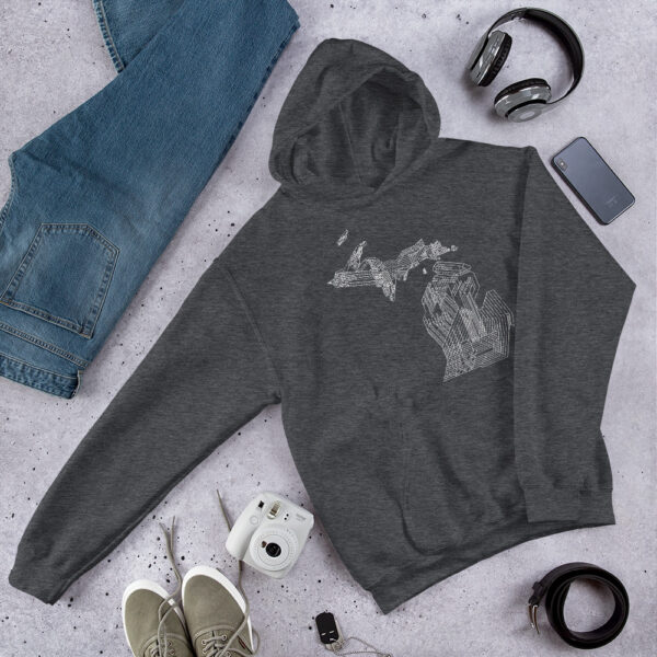 dark grey hooded sweatshirt with a white line drawing of the state of michigan on a table next to jeans